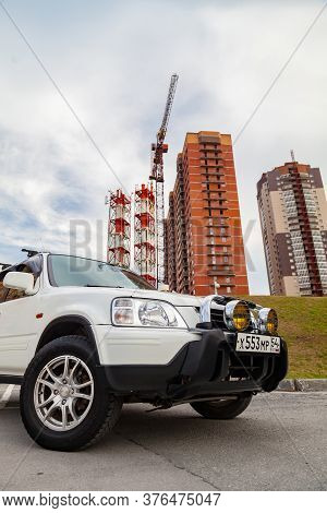 Novosibirsk, Russia - 07.07.20: Front View Of A Honda Cr-v Car In A White Body Of A Japanese Crossov