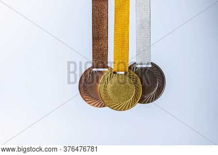Gold Medal, Silver Medal And Bronze Medal Concept For Winning Or Success