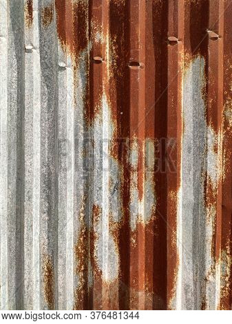 Ribbed Corroded Metal Background. Rusty Metal Background With Streaks Of Rust. Rust Stains. Rystycor