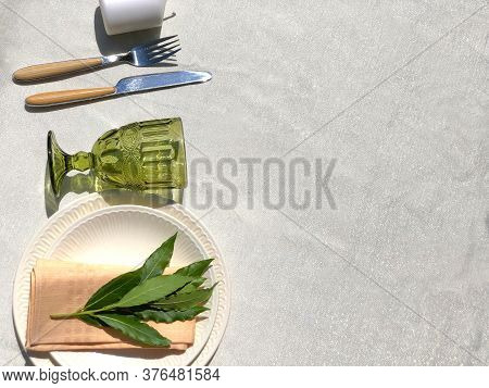 Table Set For Dinner In Garden. White Table Cloth. Rustic Wedding Table Setting Top View. Copy Space