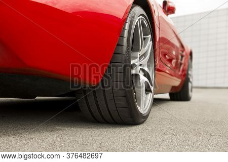 Car Wheels On Asphalt Background. Car Tires. Car Wheels Close Up. Car On The Background Of The Build
