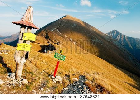 autumnal view from rohace mountains with guidepost - zapadni vysoke tatry - west high tatra mountain