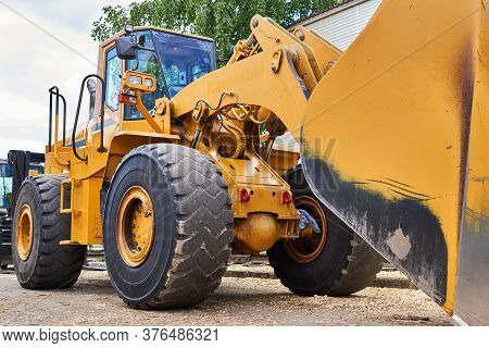 Large Industrial Wheel Bucket Loader Close-up Outdoors