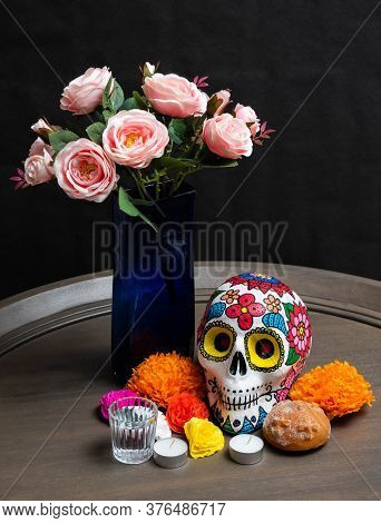 Altar For Day Of The Dead. Hand Painted Skull, Bread, Flowers, Candles And Roses On Black Background