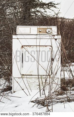 Old And Discarded Clothes Dryer During Winter