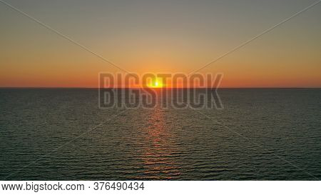 Beautiful Sunrise Over The Horizon. Aerial Photography. Sunrise In The Ocean