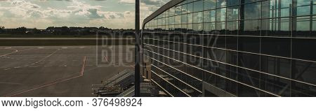 Copenhagen, Denmark - April 30, 2020: Panoramic Shot Of Glass Facade Of Airport With Airfield And Cl