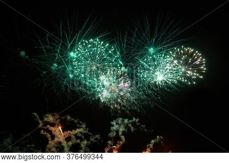 Fireworks For The Holiday From Different Colorful Explosions In The Night Sky