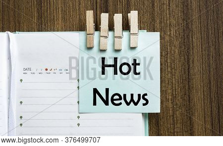 Hot Newsnotes Paper And A Clothes Pegs On Wooden Background