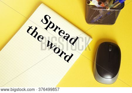 Computer Mouse, Pens, Felt-tip Pens, Notepad With Text Spread The Word On A Yellow Background