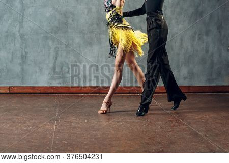 Ballroom Dance Samba. Young Couple In Yellow And Black Clothes Dancing.