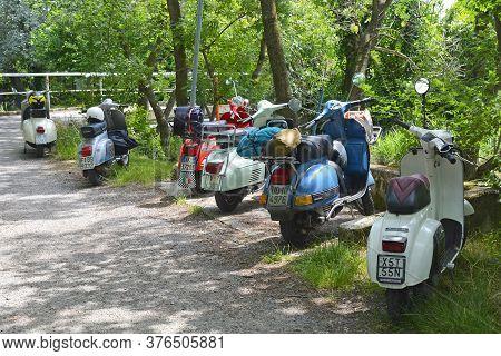 Villaggio Di Punta Sdobba, Italy - June 14 2020. Six Vespas, Part Of A Small Rally Of Vespa Motorike