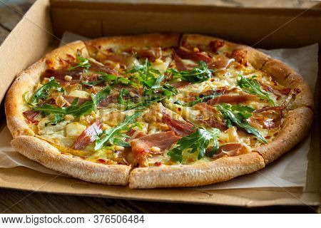 Pizza In The Box.pizza Delivery.pizza With Cheese, Jamon, Arugula And Pine Nuts.delicious Hot Pizza.