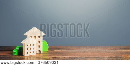 Figures Of Residential Buildings On A Gray Background. Buy Purchase And Sale, Housing Rental. Commun