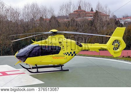 Yellow Medical Helicopter On The Runway Of A Hospital