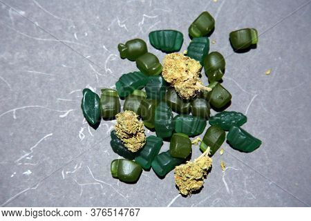 Marijuana Edibles. Edible Cannabis. Medical and Recreational Edible Marijuana Gummy Candy. Gray Background.