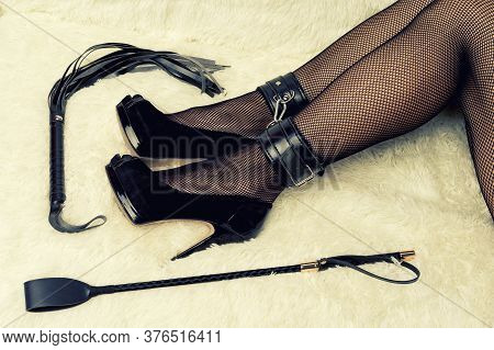 Sexy Woman Legs In High Heels Bondage With Riding Crop And Whip - Image