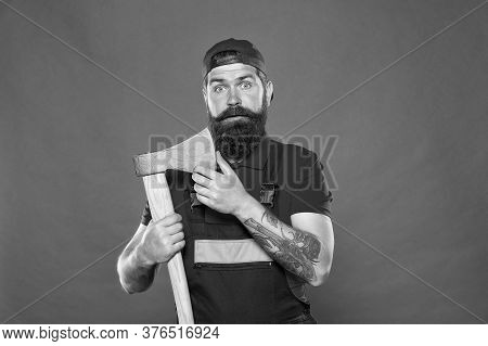 Dismantling And Demolition Of Structures. Bearded Lumberjack. Man Builder Uniform Hold Axe. Man Buil