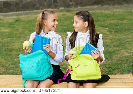 Meal Break On Fresh Air. Happy Kids Take Apples From School Bags. Little Girls Enjoy School Break Ou
