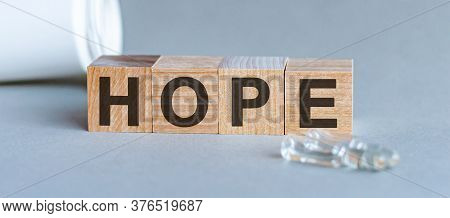 Hope - Word From Wooden Blocks With Letters, A Feeling Of Trust Hope Concept, Top View On Grey Backg