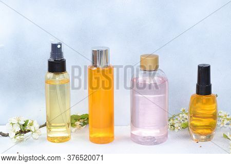 Spa And Wellness Composition With A Variety Of Lotions, Tonics And Perfumes, Aromatherapy With Rose