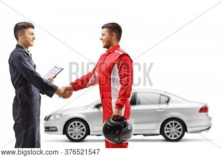 Auto mechanic shaking hands with a car racer isolated on white background