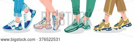 Legs In Sneakers. Female Or Male Legs Wearing Modern Sneakers, People Legs In Fashion Trainers, Styl