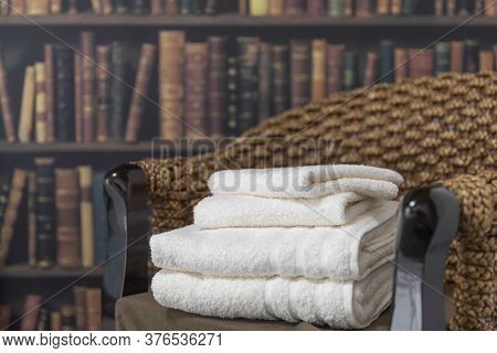 Clean Wash Towels Folded Neatly On The Chair In The Bedroom