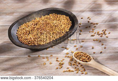Fenugreek Organic Seeds In The Wooden Bowl - Trigonella Foenum-graecum