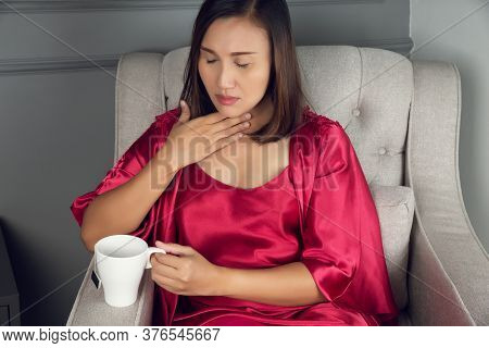 A Sore Throat Is A Pain, Scratchiness, Or Irritation, Asian Women In Red Silk Nightwear With Acid Re