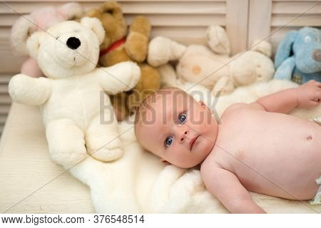 Baby Boy And White Teddy Bear. Childhood And Innocence Concept.