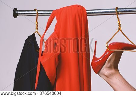 Seduction And Fashion Concept. Girls Red Shoe On Wardrobe Hanger