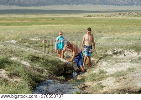 Families And Kids Enjoying Wild Willys Hot Spring In Long Valley, Mammoth Lakes, Mono County, Califo