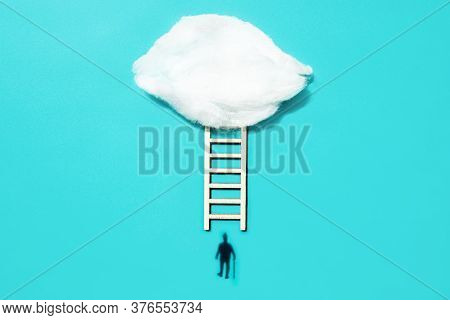 Shadow Of A Man With A Walking Stick Near A Ladder Leading Up To A Cotton Cloud. The Concept Of Pers
