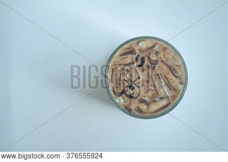 Top View Of Fresh Iced Mocha Coffee In Glass. Drink Background With Copy Space.