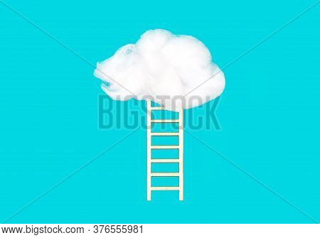 Wooden Ladder Leading Up To A Puffy Cotton Cloud On A Blue Background. Creative Success And Progress