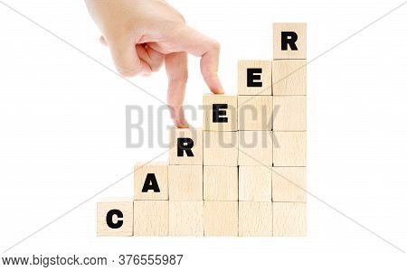 Female Hand Fingers Climbing The Stairs Made Of Wooden Blocks Spelling The Word Career Isolated On W