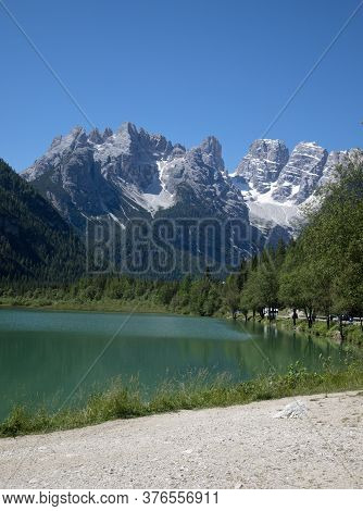 View Of The Mountain Range Of The Italian Dolomites, Trees, Blue Sky, Clouds, Alpine Lake