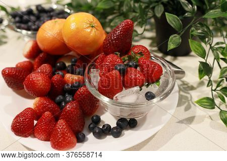 Fresh Fruits: Strawberries, Orange Berries. Fresh Nice Strawberries. Strawberry Field On Fruit Farm.