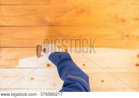 A Wooden Surface Half Coated With Protective Varnish For Wood, During Application