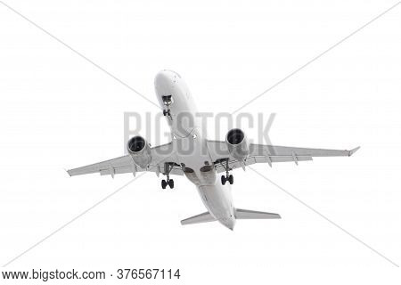 White Passenger Plane Has Released Its Landing Gear And Is Landing Isolated On White Background With