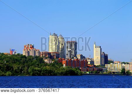Sunny Summer, Spring Morning On The Dnieper River, View Of The Monastery Island, Buildings And White