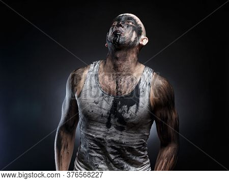 Picture Of Bald Mad Man With Black Muck In The Mouth