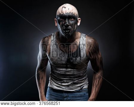 Photo Of Dirty Mad Man With Black Muck In The Mouth