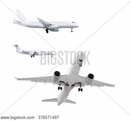 Three White Passenger Planes Has Released Its Landing Gear And Is Landing Isolated On White Backgrou