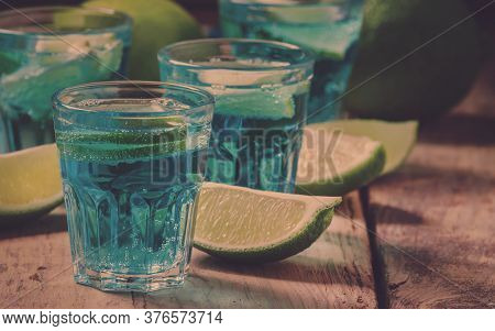 Blue Cocktail With Soda, Gin, Tonic And Lime, Selective Focus