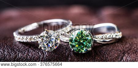 Diamond And Emerald Jewelry Rings On Leather