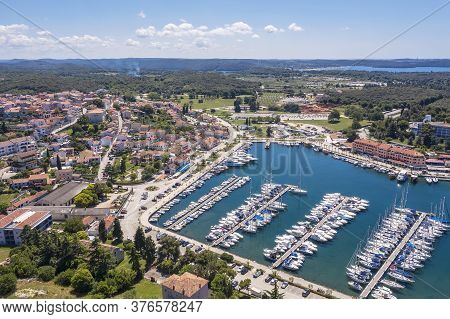 An Aerial Shot Of Coastal City Vrsar With Boats And Yachts In Marina, Istria, Croatia