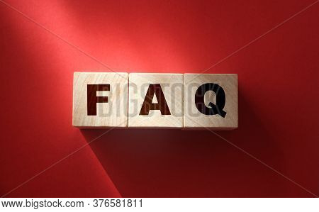 Faq Text On Wooden Cubes On Red. Frequently Asked Questions. Business Concept