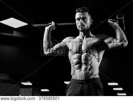 From Below View Of Strong Muscular Man Holding Big Sledgehammer. Monochrome Portrait Of Shirtless Ca